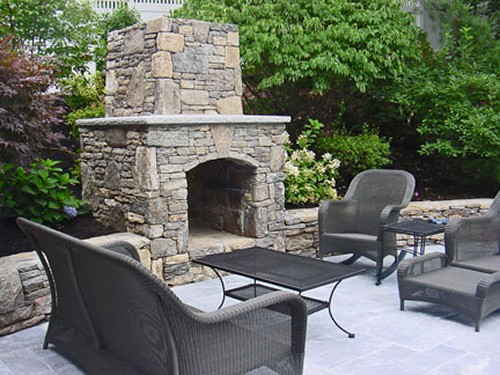 Fieldstone Fireplace with Travertine Mantle and Arched Box; Fireplace, Patio and Sitting Wall by New View