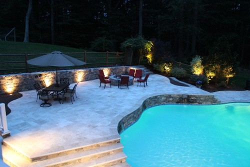 Pool with Elevated Travertine Deck and Steps, Stone Wall and Waterfall by New View