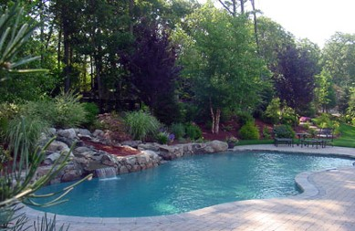 Pool, natural waterfall, landscape and hardscape by New View
