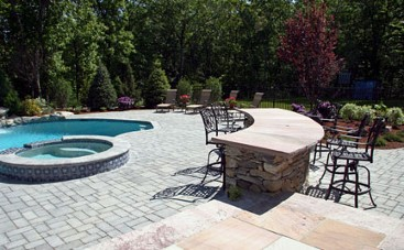 Curved bar, pool with spa, patio and landscape by New View