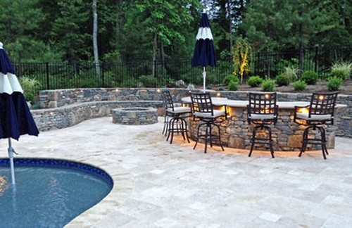 Curved Bar with Umbrella Holders, Patio and Landscape by New View