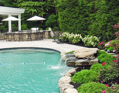 Pool with Waterfall and Stone Bar by New View