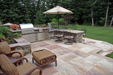 Stone bar with two level seating. Stone work, landscaping and design by New View