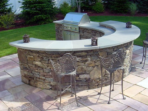 Curved Bi Level Bar with Blue Stone Top and Built in Grill by New View