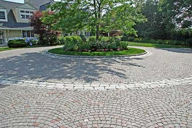 Cobblestone driveway and landcape by New View