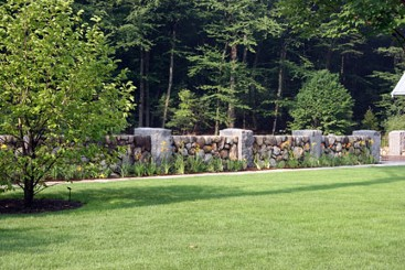 Field stone and granite post wall with landscape by New View