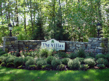 Stone wall with post for signage and landscape by New View