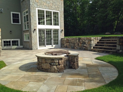 Fire Pit with Granite Patio, Travertine Topped Steps and Retaining Wall by New View