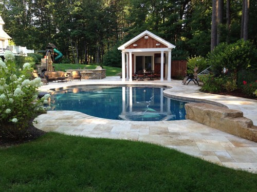 Free Form Pool with Waterfall, Diving Rock, Stone Bar and Travertine Deck