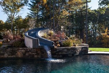 Pool with slide, travertine and fieldstone by New View