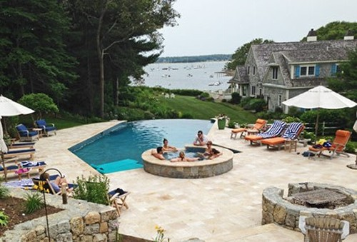 Infinity Edge Pool, Spa, Fire Pit, Travertine Patio and Landscape by New View