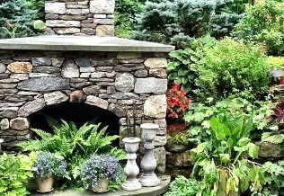 Fieldstone Fireplace and landscape planting by New View Inc.