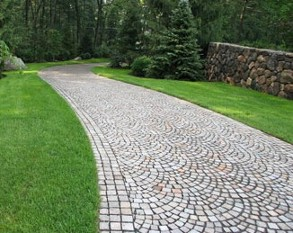 Cobblestone Driveway with stone walls and Privacy Tree Planting by New View
