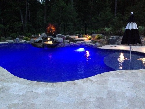 Pool with Wading Shelf, Night Lights, Waterfall and Travertine Coping by New View