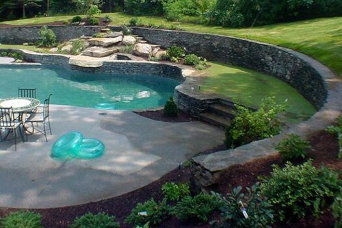 Pool with Retaining Wall, Waterfall and Stone Steps by New View