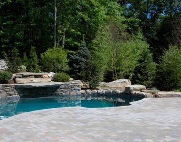 Free Form pool with travertine deck and pergola