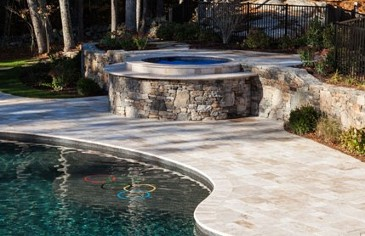Travertine topped spa with free form pool and travertine coping by New View