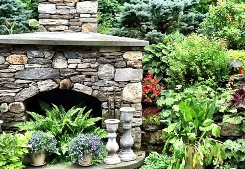 Landscape and Stonework Outdoor Fireplace by New View, Inc.