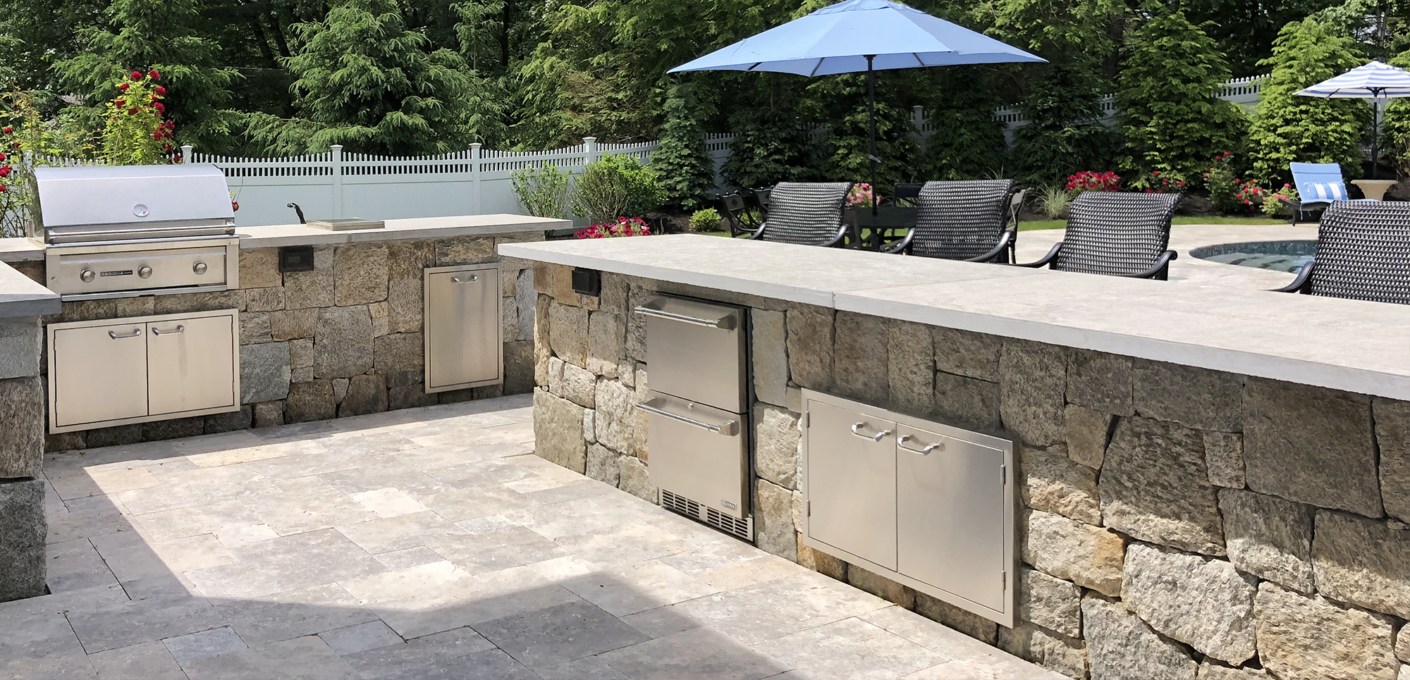Patio,Landscaping, Stone Bars complete with Grill, Refrigerator drawers & Trash center by New View, Inc.