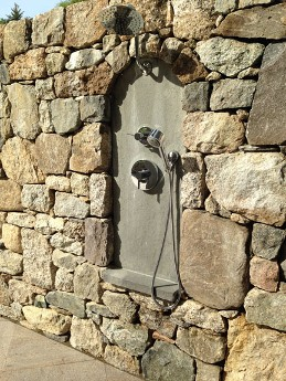 Fieldstone Wall with Outdoor Shower by New View