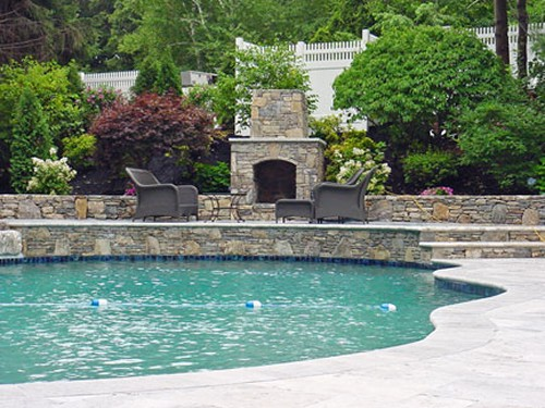 Free Form Pool, Fieldstone Elevated Patio& Fireplace with Travertine Deck by New View