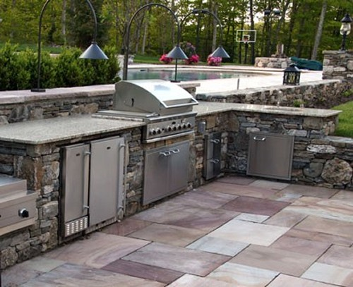 Sunken, L Shaped Stone Bar with Built in Grill, Wok Burner, Refrigerator and Pool with Stone Posts by New View