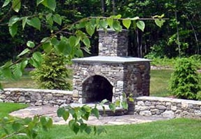 Arched Front Fireplace with Blue Stone Mantle and Patio by New View